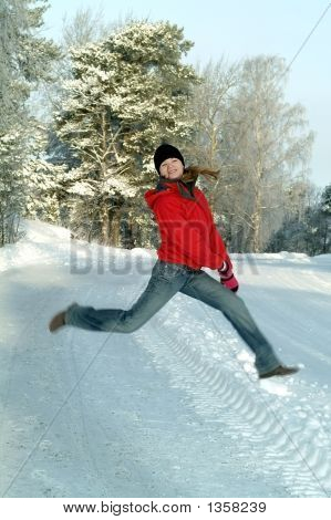 Young Girl Jumping On Winter