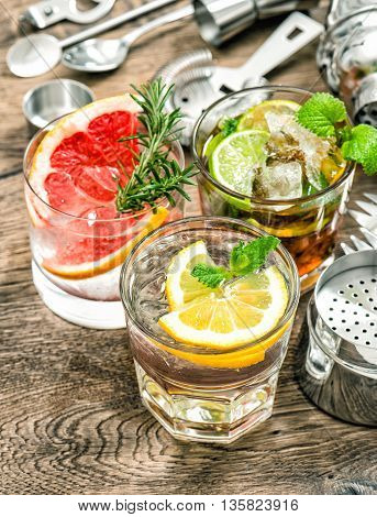 Cocktails with fruits and ice. Cold drinks with mint