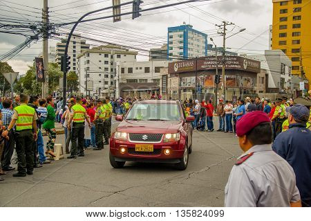 QUITO, ECUADOR - JULY 7, 2015: Pope Francisco making a visit on the streets of Ecuador, car on the front with body guards.