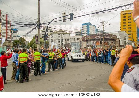 QUITO, ECUADOR - JULY 7, 2015: Nice and emotional moment, people saying welcome to pope Francisco in Ecuador, popemobile.