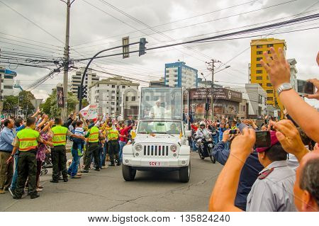 QUITO, ECUADOR - JULY 7, 2015: Welcome pope Francsico to Ecuador, people on the streets trying to see and touch him.