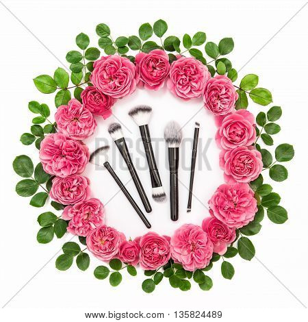 Roses with green leaves isolated on white background. Flower head wreath. Pink rose flowers. Beauty flat lay concept