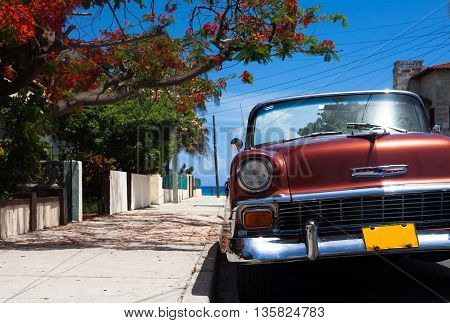 Red american cabriolet classic car parked in Varadero Cuba