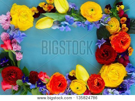 Fresh Flowers festive frame with copy space on blue wooden table background