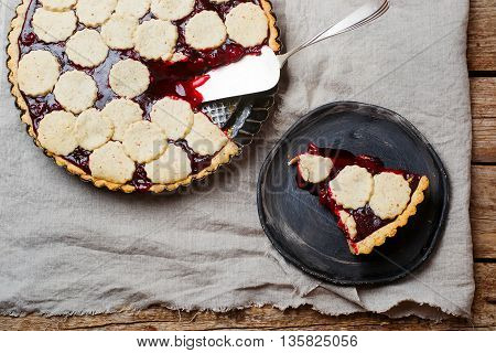 almond tart with cherry. top view. style vintage. selective focus