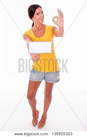 Smiling Young Brunette With Blank Envelope