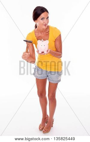 Smiling Young Brunette With Piggy Bank