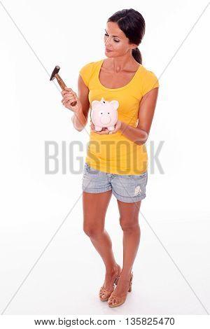 Wondering Brunette Woman Holding Piggy Bank