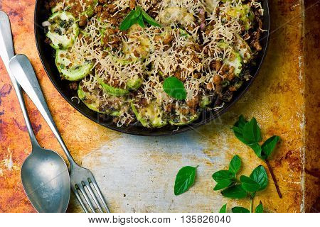 gratin from vegetable marrows with herbs. style vintage. top view. selective focus