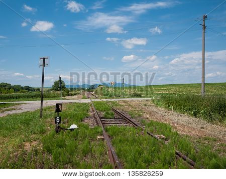 Railway tracks with blue sky and clouds