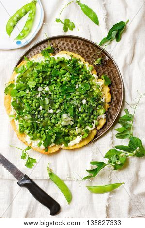 vegetable tart with green peas. selective focus.