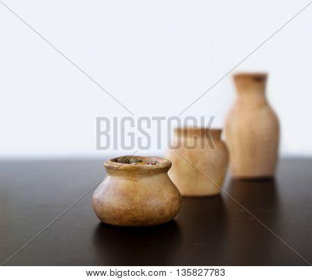 Ceramic jars on black background. Jars of different shapes.