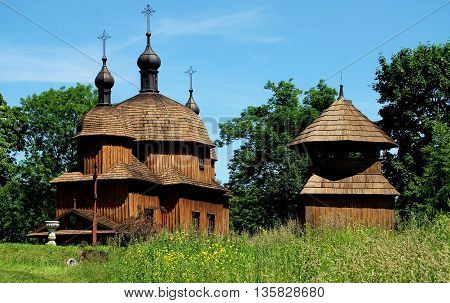 Lublin Poland- June 6 2010: 1759 St. Nicolas Greek Orthodox church and small wooden belfry at the Regional Ethnographic Museum known as Skansen