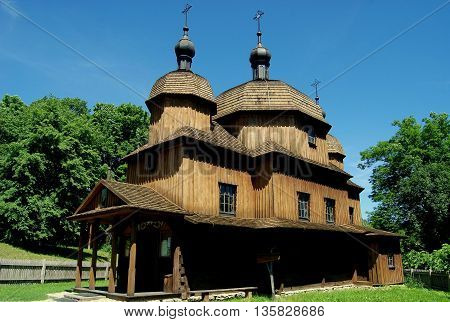 Lublin Poland - June 5 2010: 1759 St. Nicolas Greek Orthodox church and small wooden belfry at the Regional Ethnographic Museum known as Skansen