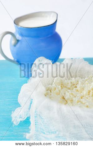 curd cheese with a jug of milk