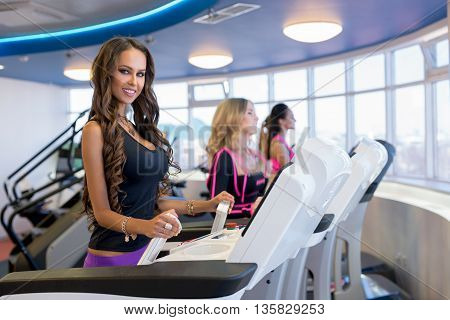 Beautiful brunette posing during training on simulator