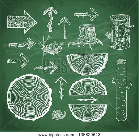 Skethces of wood cuts, logs, stump and wooden arrows on blackboard background.