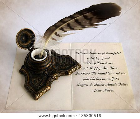 Antique Bronze inkpot with feather and handwritten congratulatory text in four languages to send foreign friends - Local sepia toned artwork in retro style
