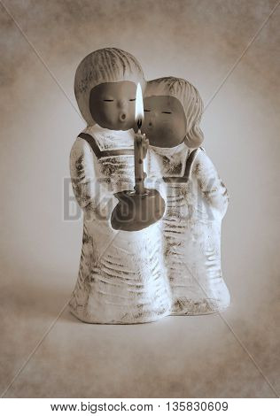 Ceramic candlestick in the form of angels with burning candle - Duotone artwork in retro style