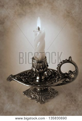 Photo shows the bronze candlestick with burning candle - Duotone artwork in retro style