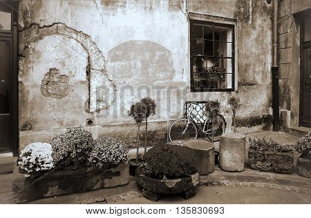 Picturesque wall of an old house in the evening time - Duotone artwork in retro style