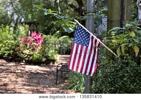An American Flag at the entrance of Nature Coast Botanical Garden in Spring Hill, Florida.