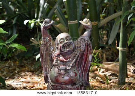 Happy Buddha in the Asian garden at Nature Coast Botanical Garden in Spring Hill, Florida.