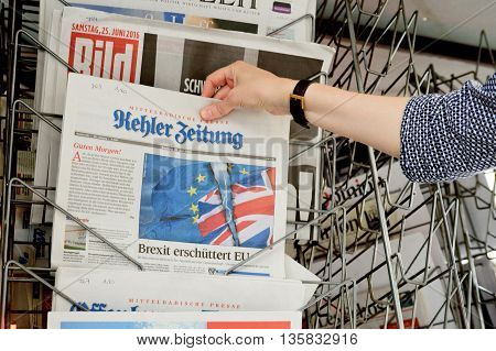 Woman Buying Kehler Zeitung Newspaper With Shocking Headline About Brexit