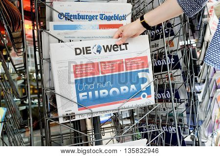 Woman Buying Die Welt Newspaper With Shocking Headline About Brexit