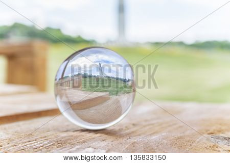 leisure concept in the city.Crystal ball on a wooden table.