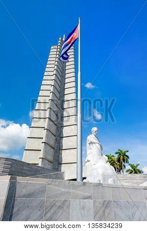 HAVANA,CUBA - JUNE 22,2016 : Monument and cuban flag at the Revolution Square in Havana on a beautiful summer day
