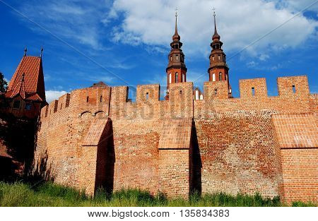 Opole Poland - June 16 2010: Reconstructed medieval city walls with crenellations and towers of Holy Cross Cathedral