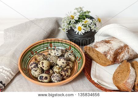 Natural Products: quail eggs and homemade bread on the table
