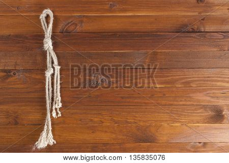 The background texture image of wooden planks and rope. Old background.