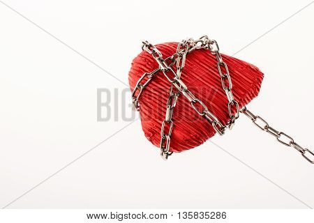 Red color heart shaped object in Chain on white background