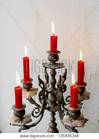 Retro Candlesticks With Red Candles On The Background Of The Old Wall