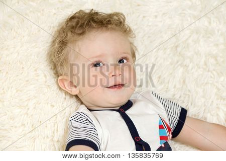 Portrait Of A Beautiful Little Boy With Curly Hair