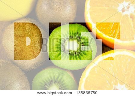Healthy lifestyle concept with fresh kiwifruits, oranges and lemon with the word diet