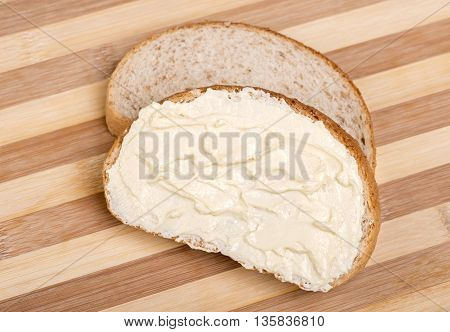Close up Slices of bread spread with butter