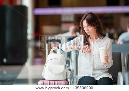 portrait of passenger in an airport lounge waiting for flight aircraft