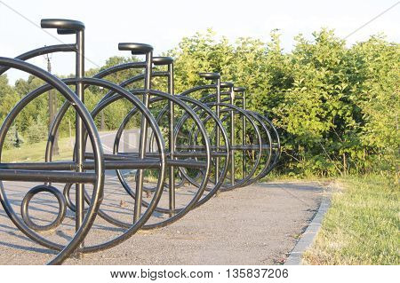 Parking for bicycles on the bike path. Metal tubes welded in a bicycle.