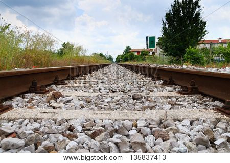 Train tracks in perspective. Transportation outdoor detail