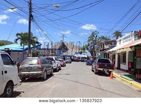 SAN JUAN DEL SUR NICARAGUA - SEPTEMBER 21 2015: Randomly electric wires stretched over the street in San Juan del Sur