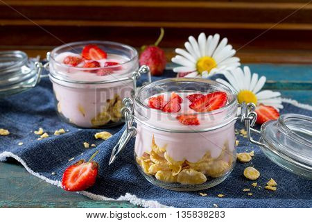 Homemade Yogurt With Corn Flakes And Berries, Healthy Eating Yogurt In The Rustic Style.
