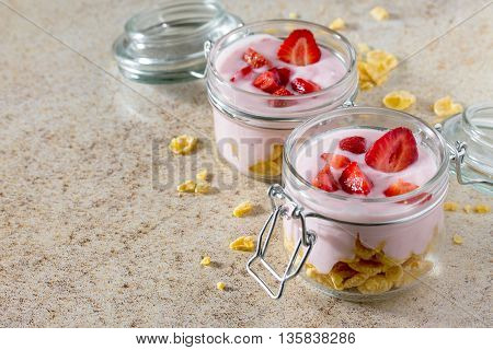Homemade Yogurt With Corn Flakes And Berries, Healthy Eating Yogurt On A Brown Stone Background.
