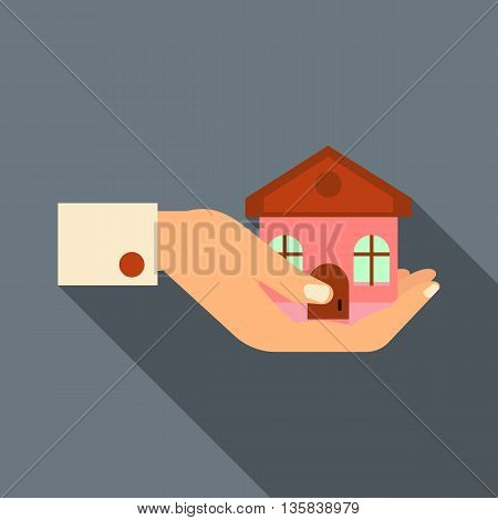 Hand holding house icon in flat style with long shadow. Real estate symbol