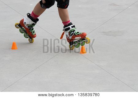Girl Skating In Two Wheels With Cones