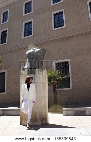 Woman In White Suit In San Bruno's Square, Zaragoza, Spain
