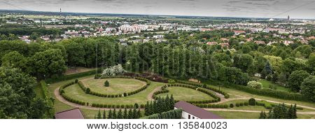 View of the town of Chelm in eastern Poland. In the foreground a garden with a living rosary in the park next to the Basilica of the Virgin Mary