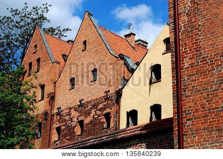 Torun Poland - May 26 2010: 15th century Hanseatic style houses seen from the old city defense walls